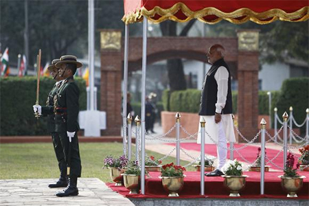 Prime Minister Narendra Modi watches a guard of honour upon his arrival for the 18th South Asian Association for Regional Cooperation (SAARC) summit in Kathmandu November 25, 2014.